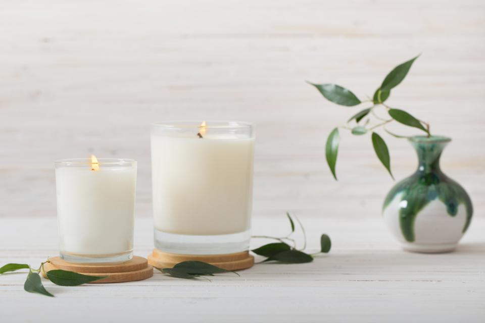 scented candles on white background