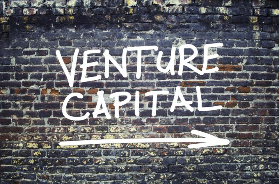 Venture capital text on brick wall