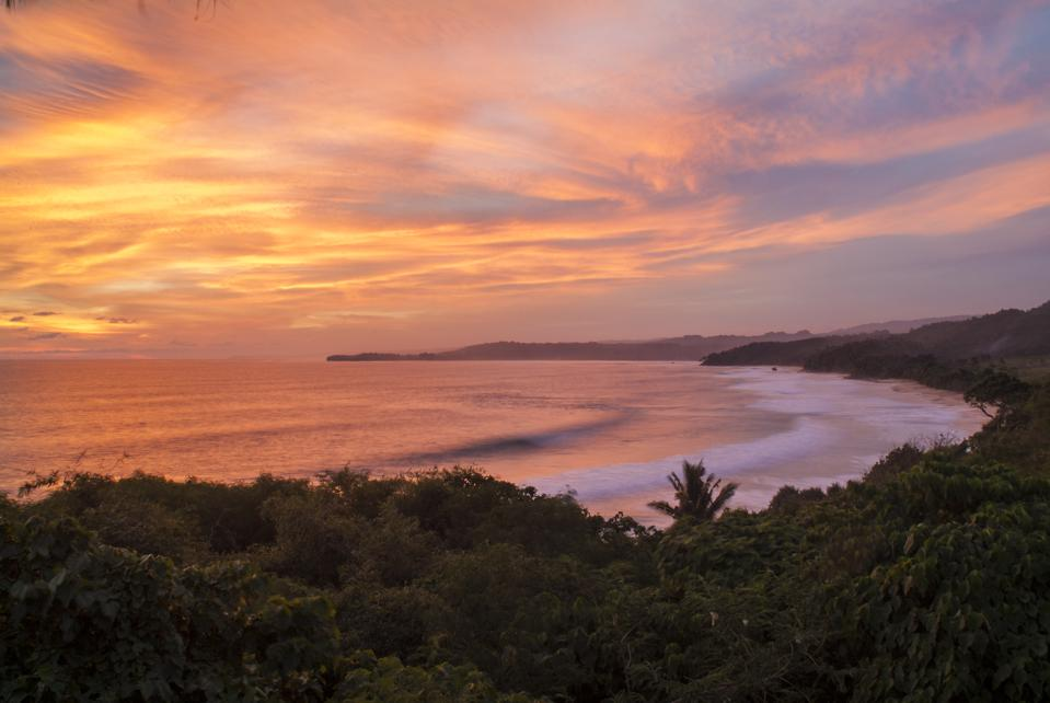 Sunset over the beach at Nihiwatu, a resort on Sumba in...