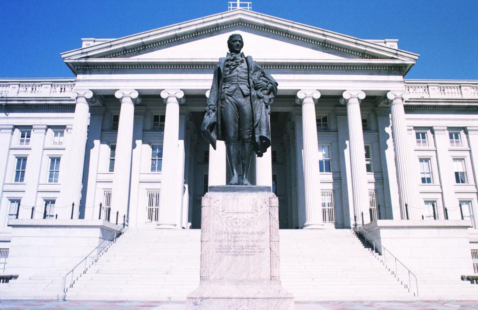 The Sculpture Of Alexander Hamilton The First Secertary Of The Treasury Stands In Fron