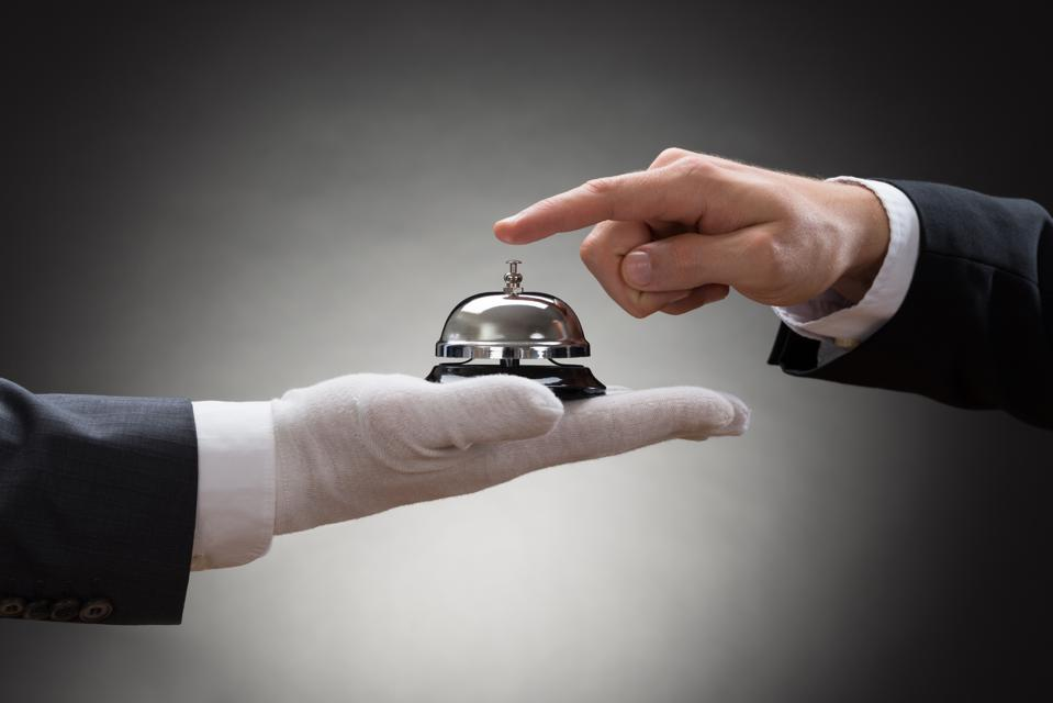 Close-up Of A Person's Hand Ringing Service Bell