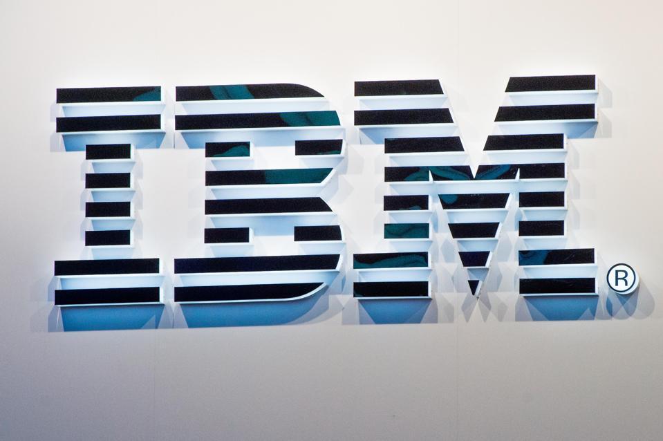 IBMu0027s logo sits illuminated outside the IBM
