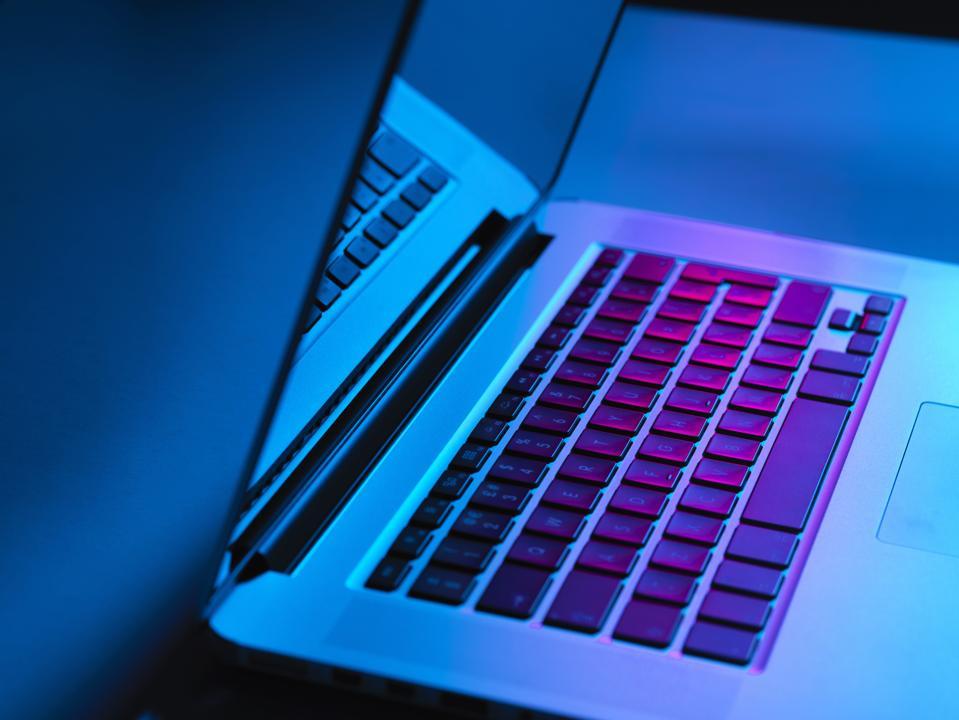 Laptop on office desk at night