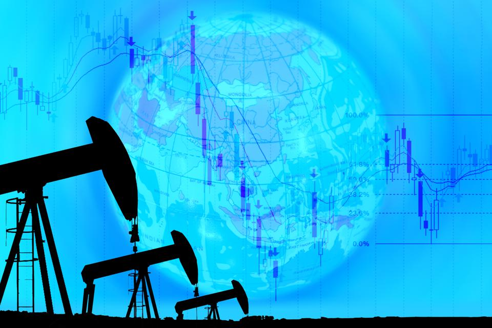 industrial pump jack and falling oil graph on  globe background