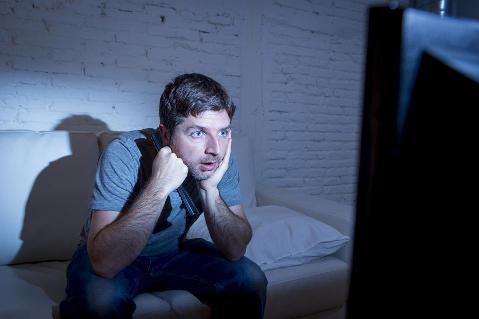 Man staring at TV