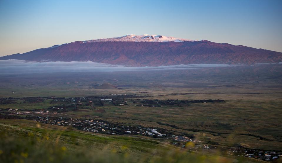 Magnificent and Snow Capped Mauna Kea Looms over the Landscape