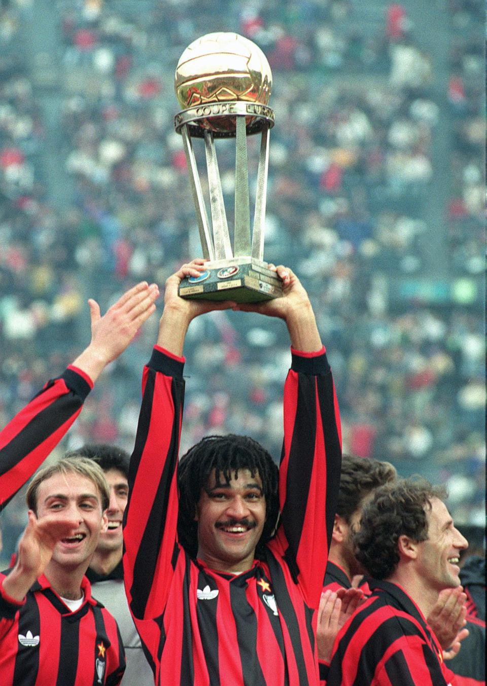 AC Milan's Dutch forward Ruud Gullt smiles as he h