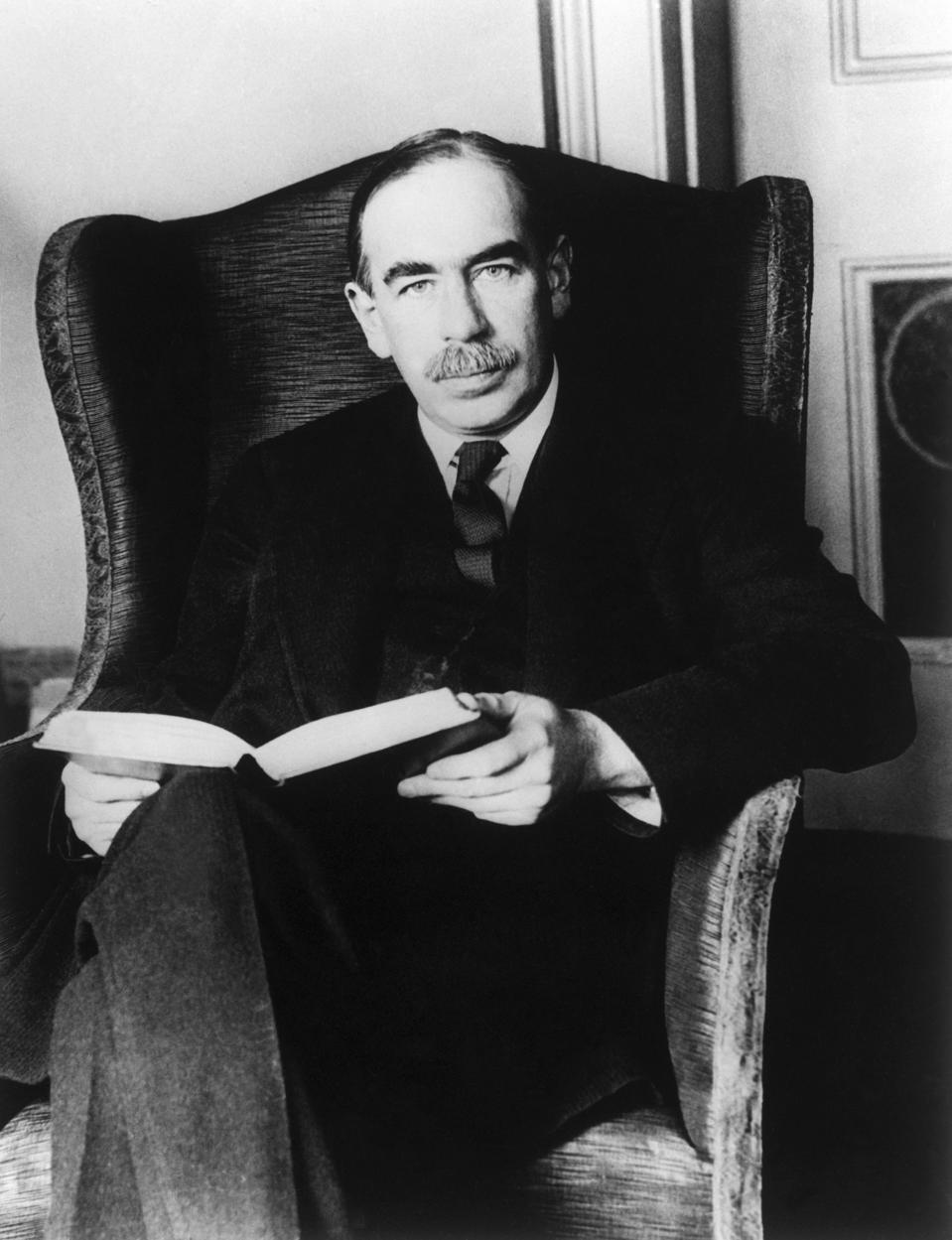 John Maynard Keynes Holding a Book