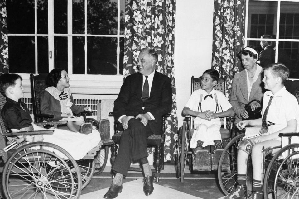 President Franklin and Mrs. Roosevelt meet with young polio patients