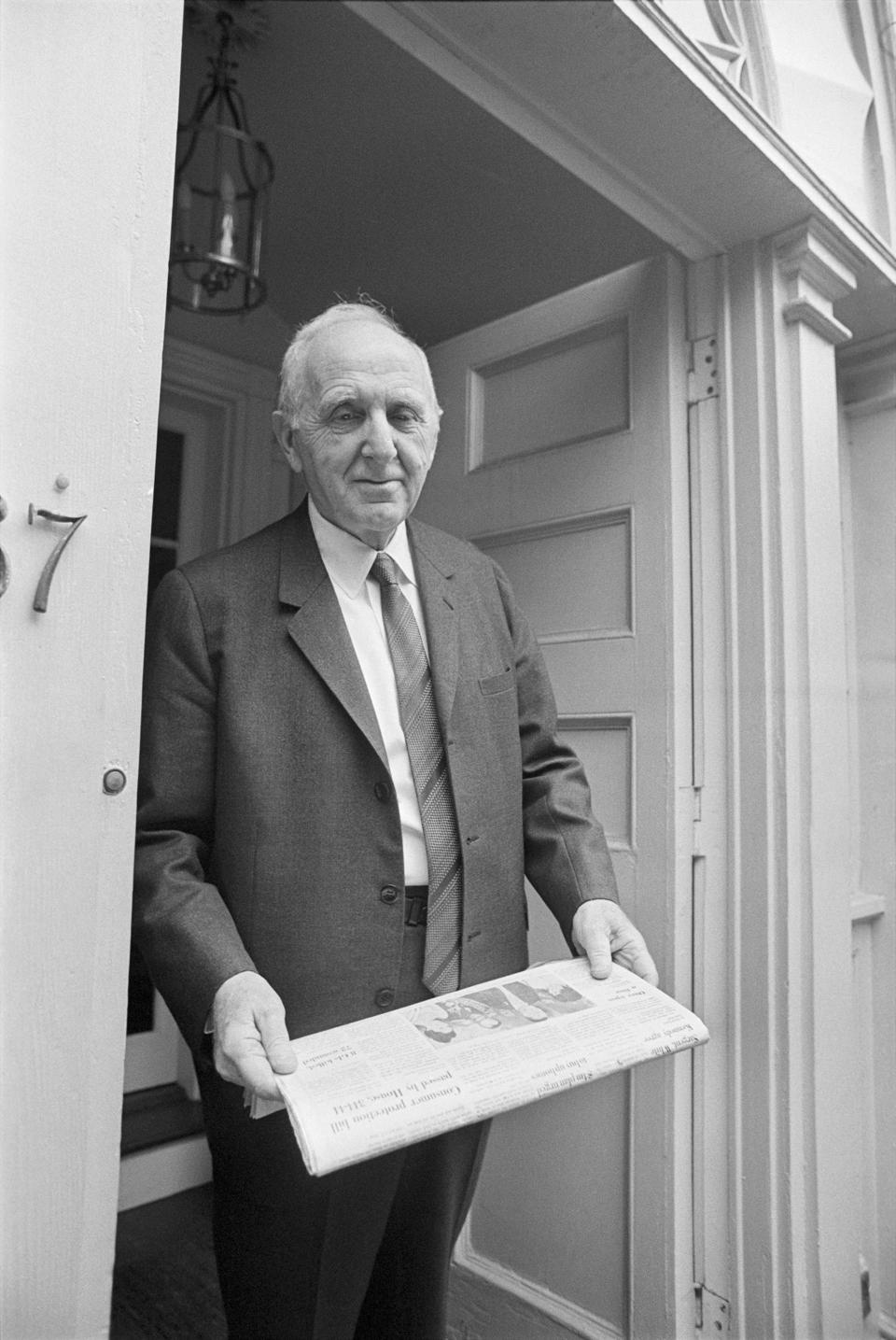 Simon Kuznets Standing in a Doorway