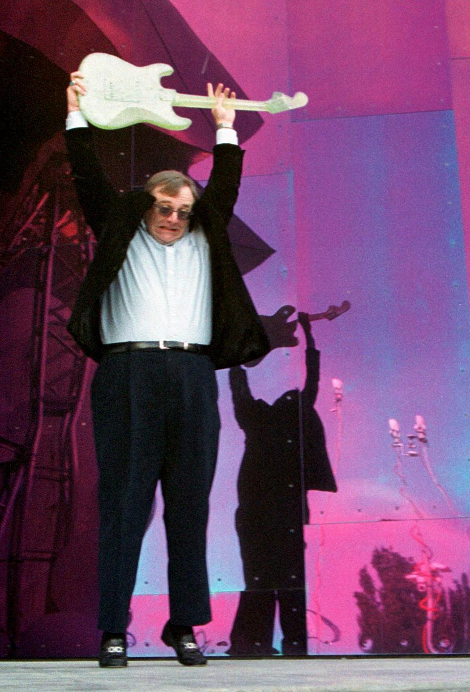 Microsoft co-founder Paul Allen christens his Experience Music Project.