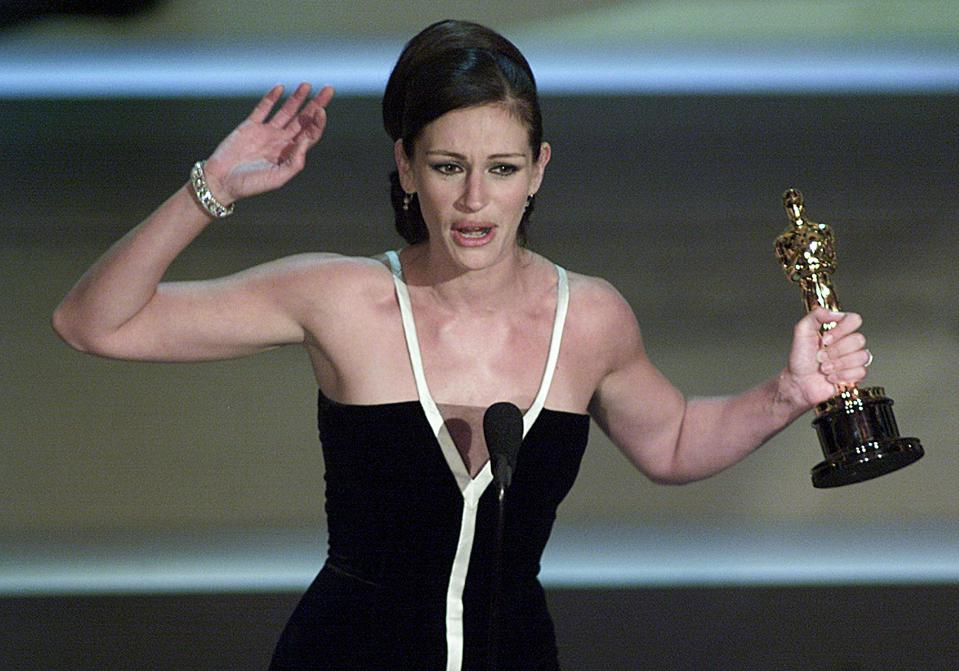 Actress Julia Roberts holds her Oscar for Best Act