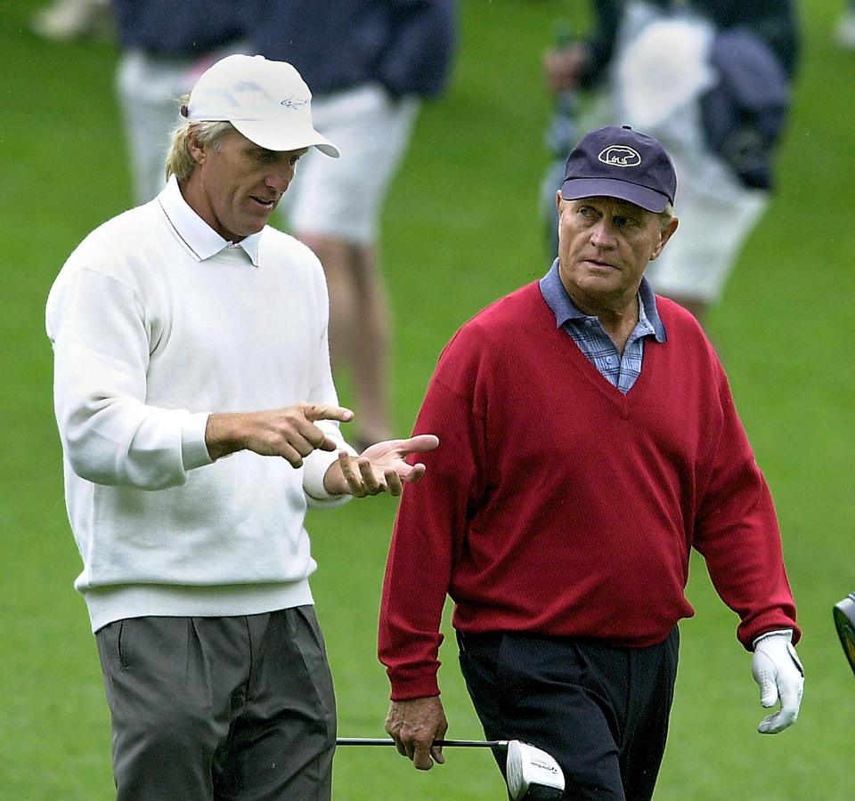 Greg Norman talks with six-time Masters champion Jack Nicklaus.