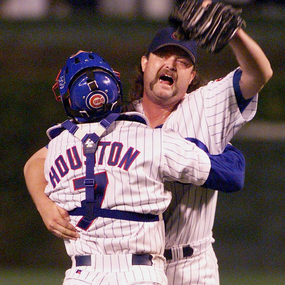 Pitcher Rod Beck(R) of the Chicago Cubs hugs catch