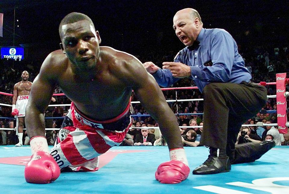 Hasim Rahman (C) of the US is counted out by refer