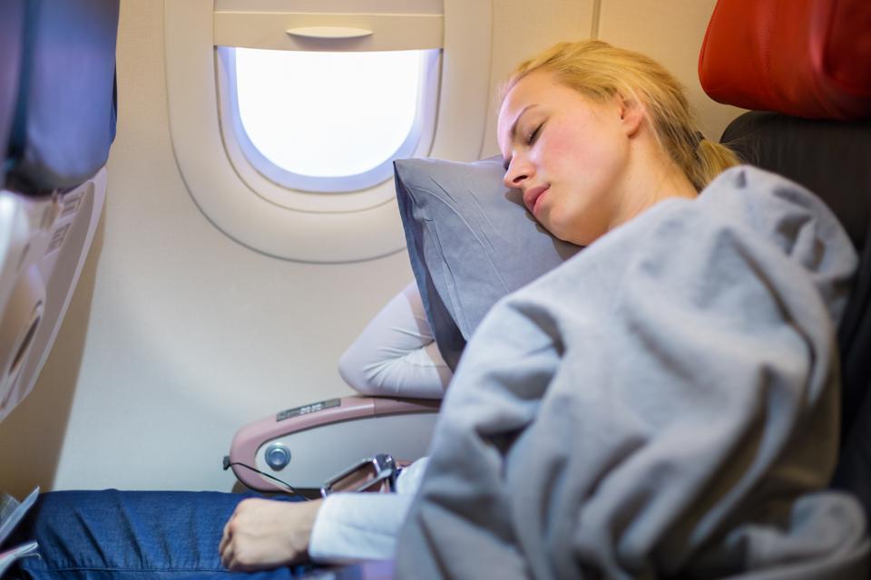 How to sleep on a plane like a pro.