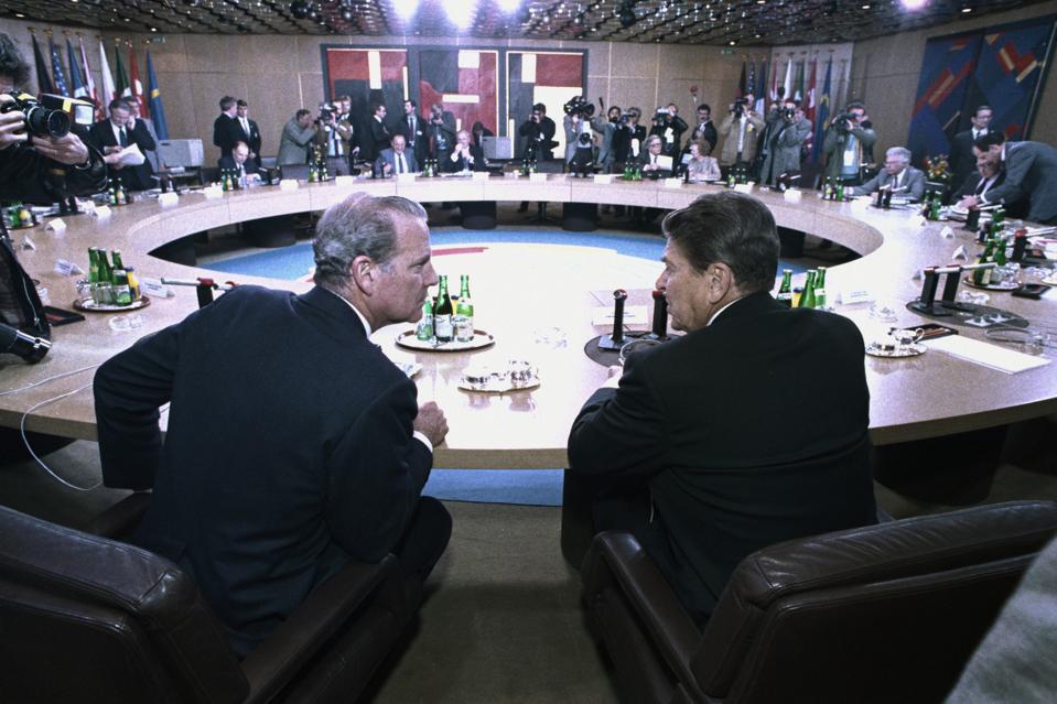 President Ronald Reagan and James Baker Conversing While at Summit