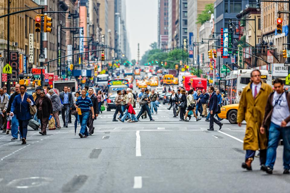 Commuters crossing 8th Avenue in New York City, USA