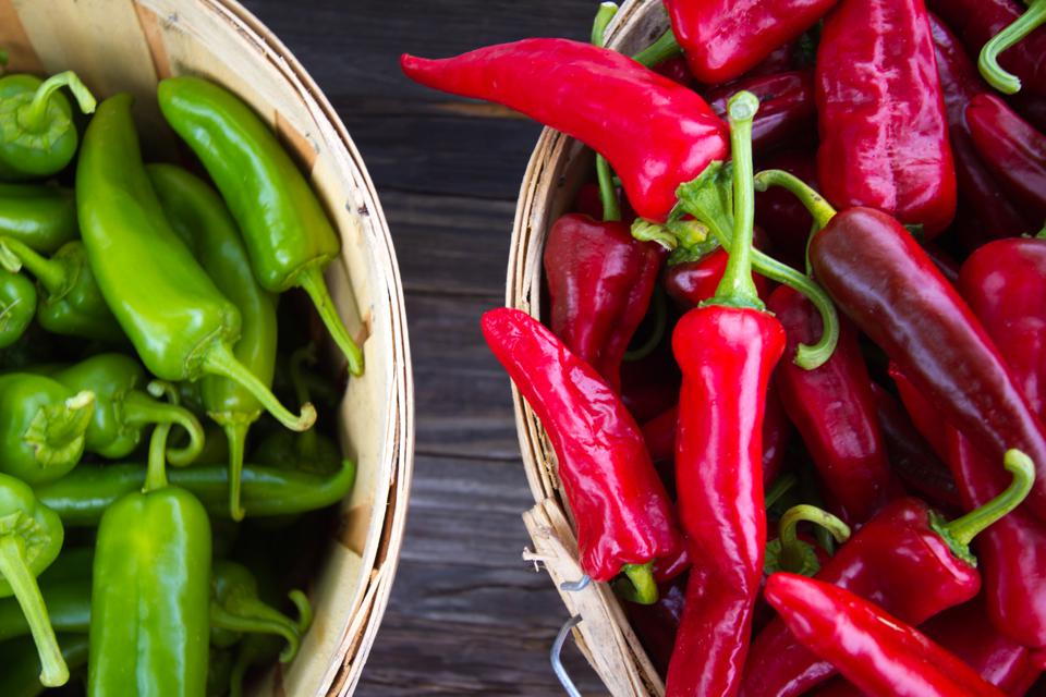 Red and Green Chile Peppers in Bushel Baskets