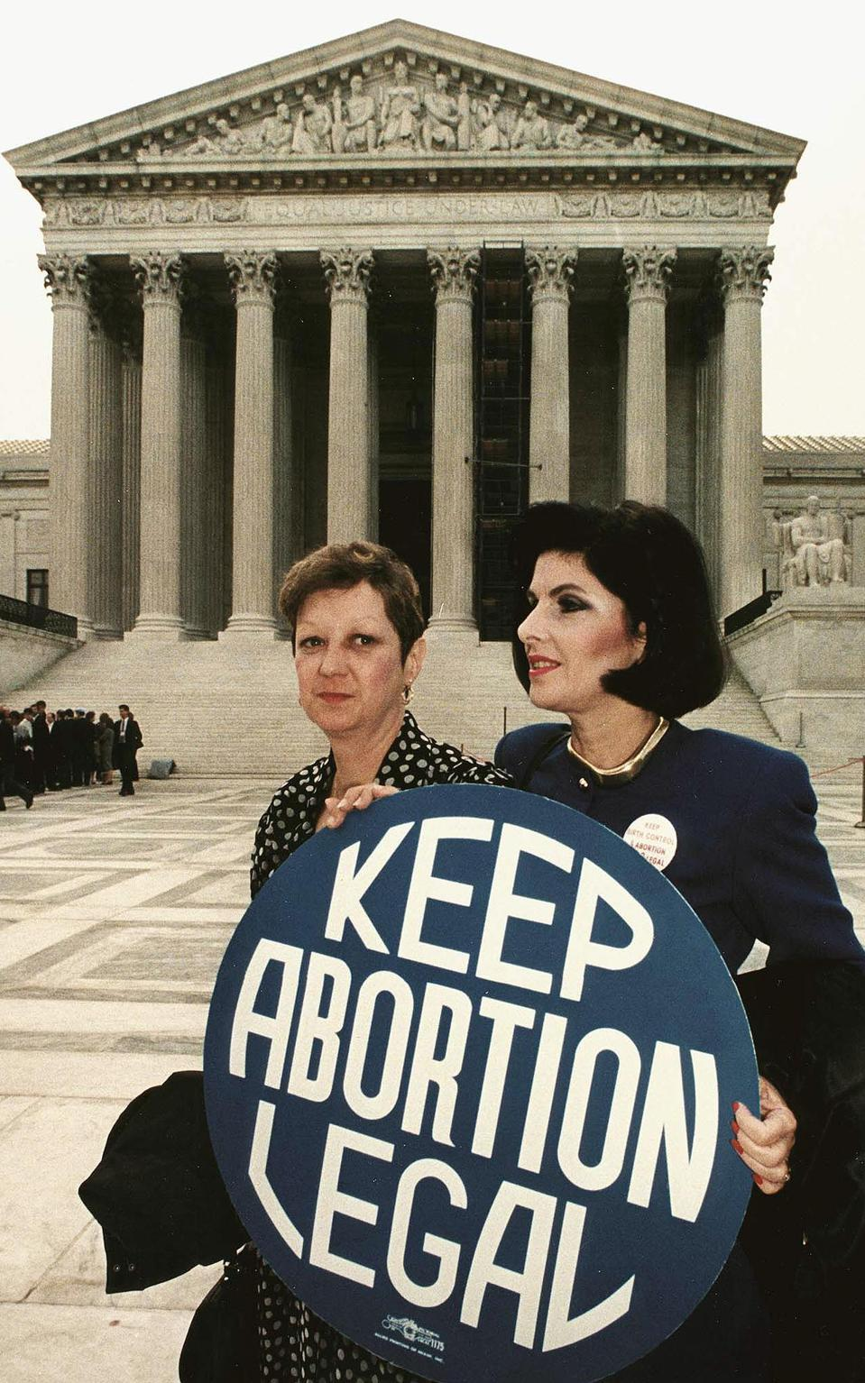 This file photo shows Norma McCorvey(L) formally k