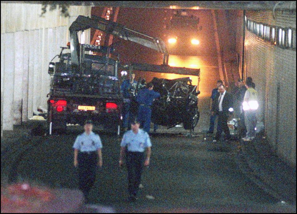 The wreckage of Princess Diana's car is lifted on