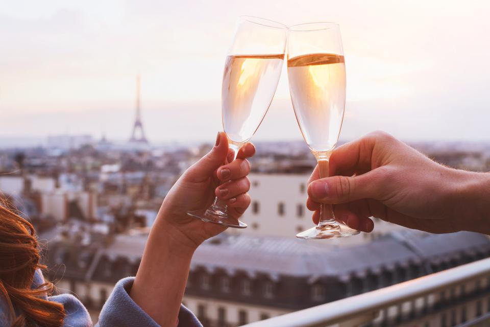 couple drinking champagne in Paris