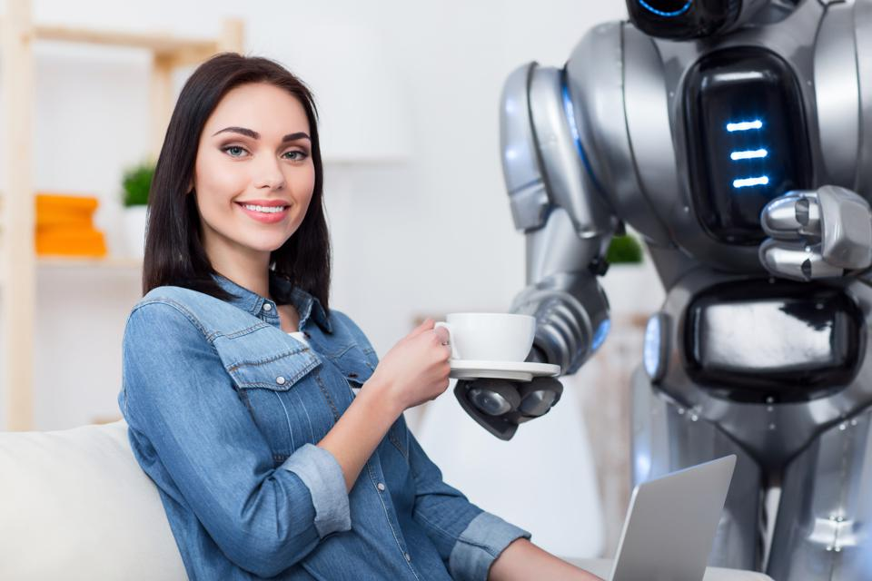 women sitting on the couch w/ robot