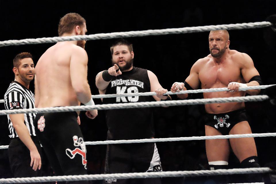 WWE stars Triple H, Kevin Owens and Sami Zayn