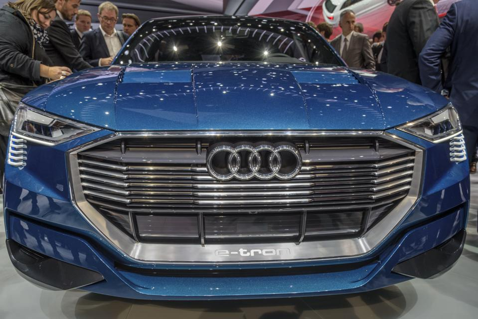 Typically, the Audi's signature single-frame grille is dark and foreboding. The e-tron's grille is metallic, less menacing, and more indicative of the vehicle's dynamic nature.