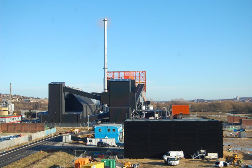 Stark black and orange rectangular structures of a biomass power plant in Sheffield, U.K.