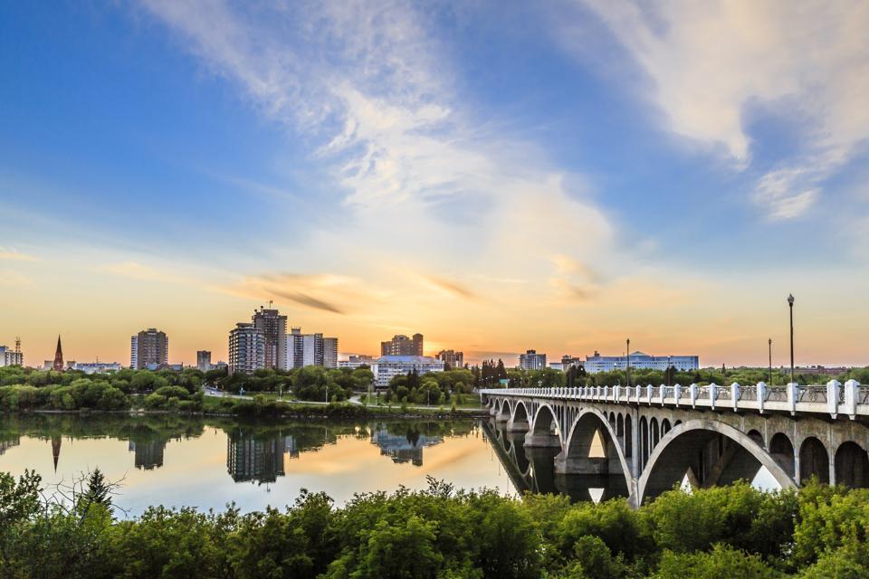 Sunset over the City of Saskatoon Canada's new coronavirus travel rules for provinces