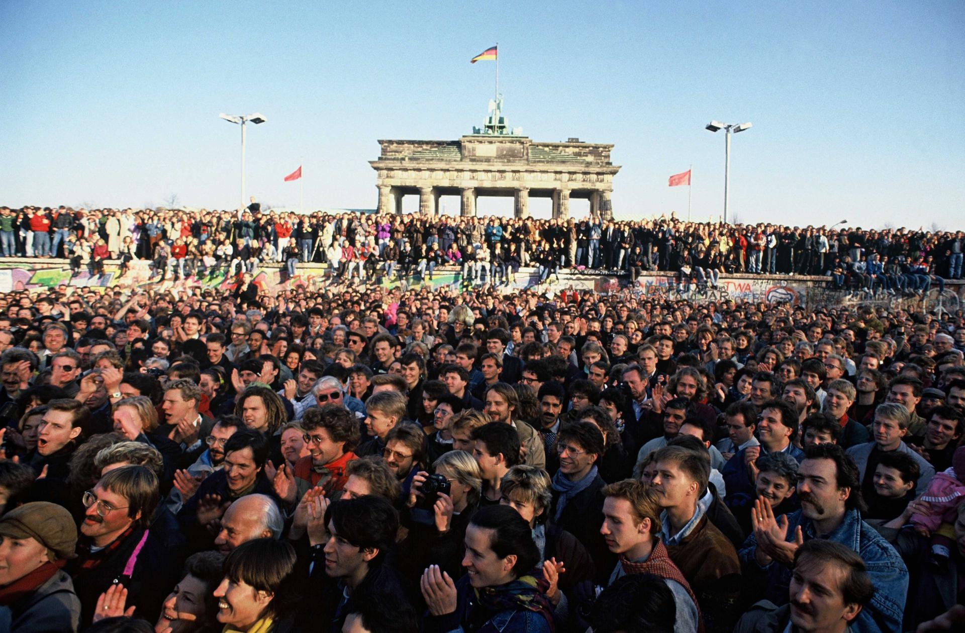 Thousands of people rushed to the Berlin Wall in the first few days after the opening of the Wall on November 9th, 1989