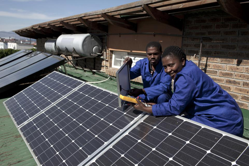 Students install solar panels in Cape Town, South Africa