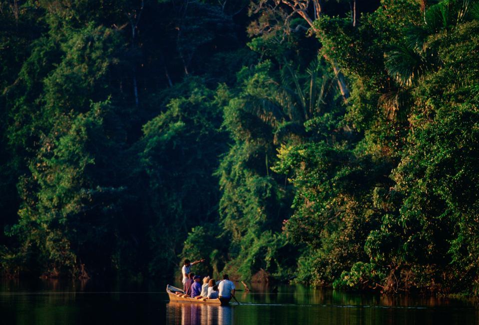 Tourists, Lake Sandoval, Peru Rain Forest amazon philanthropy travel