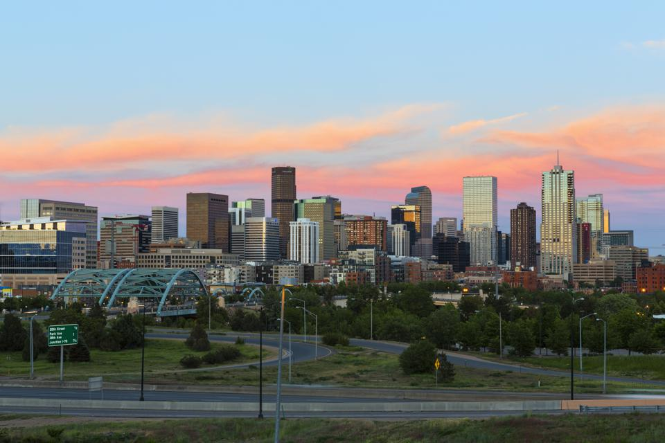 USA, Colorado, Denver, Cityscape with Interstate Highway at sunet