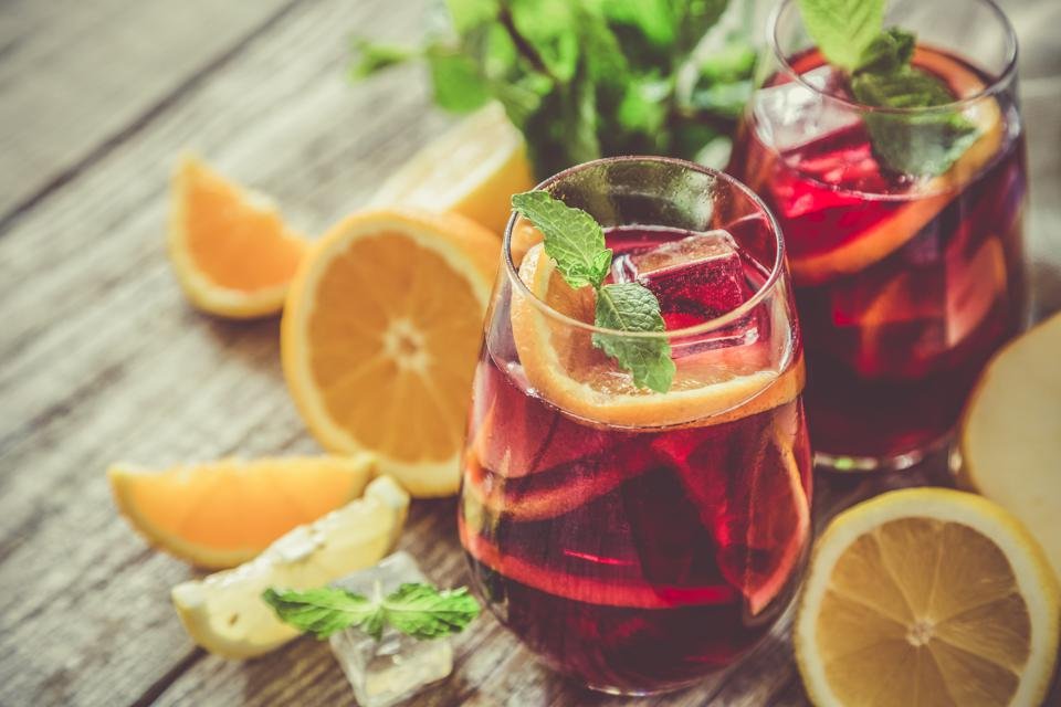 Sangria and ingredients in glasses