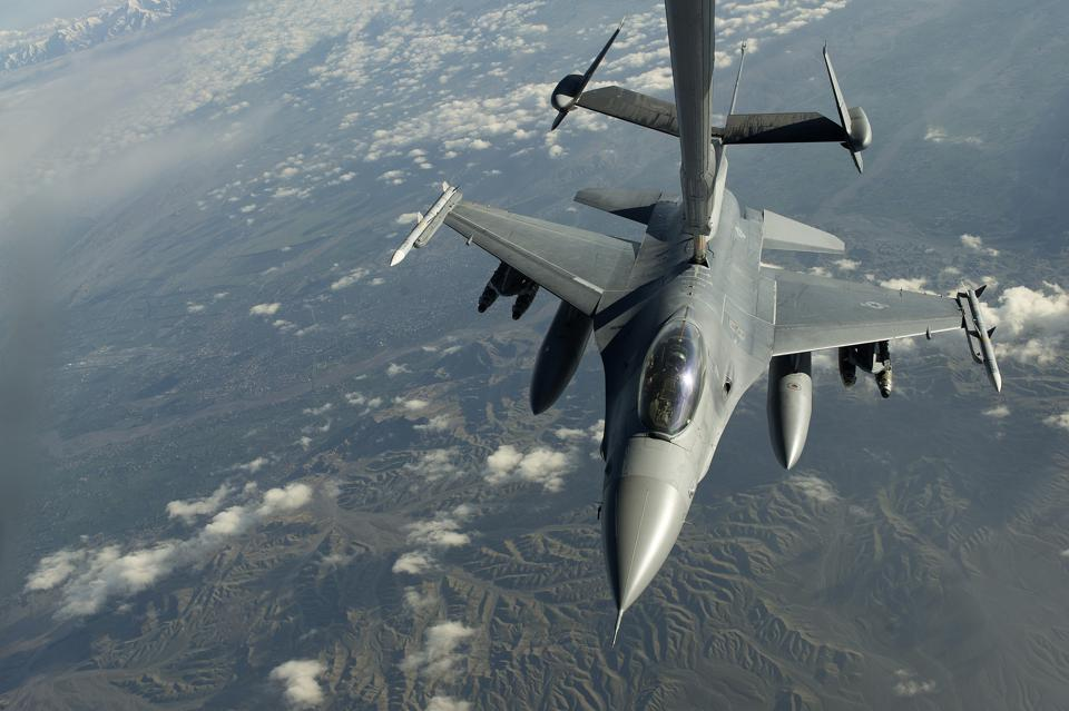 A U.S. Air Force F-16C Fighting Falcon conducts aerial refueling.