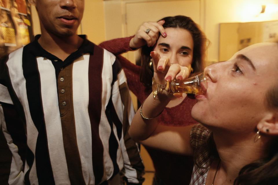 College Students Drink Shots of Alcohol at Party