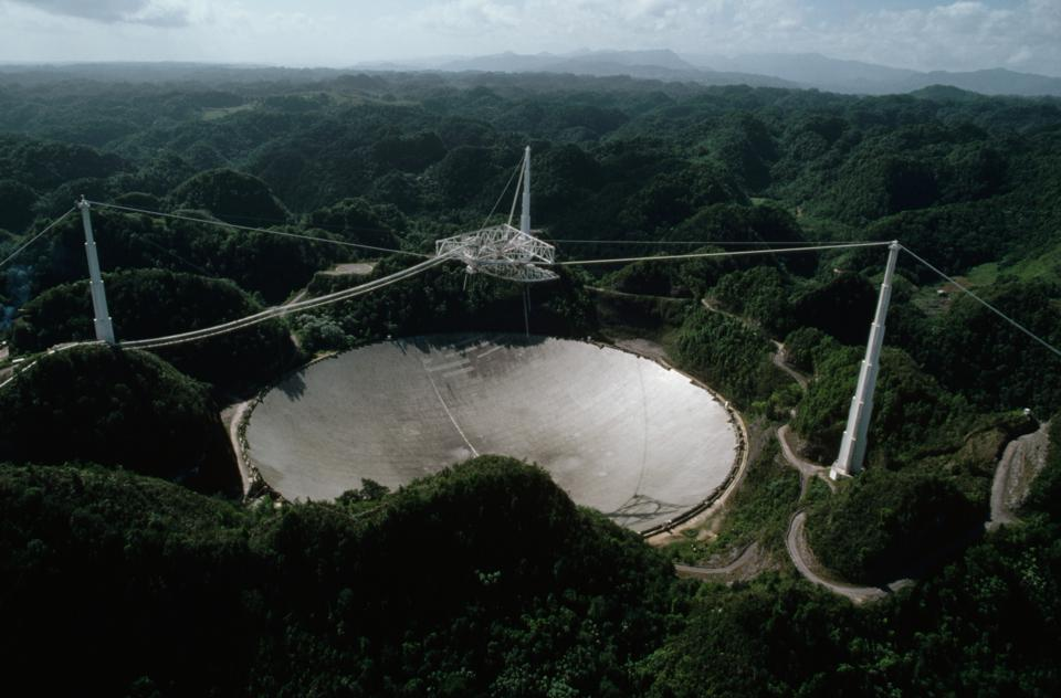 The Arecibo Radio Telescope on Puerto Rico receives interplanetary signals and transmissions.