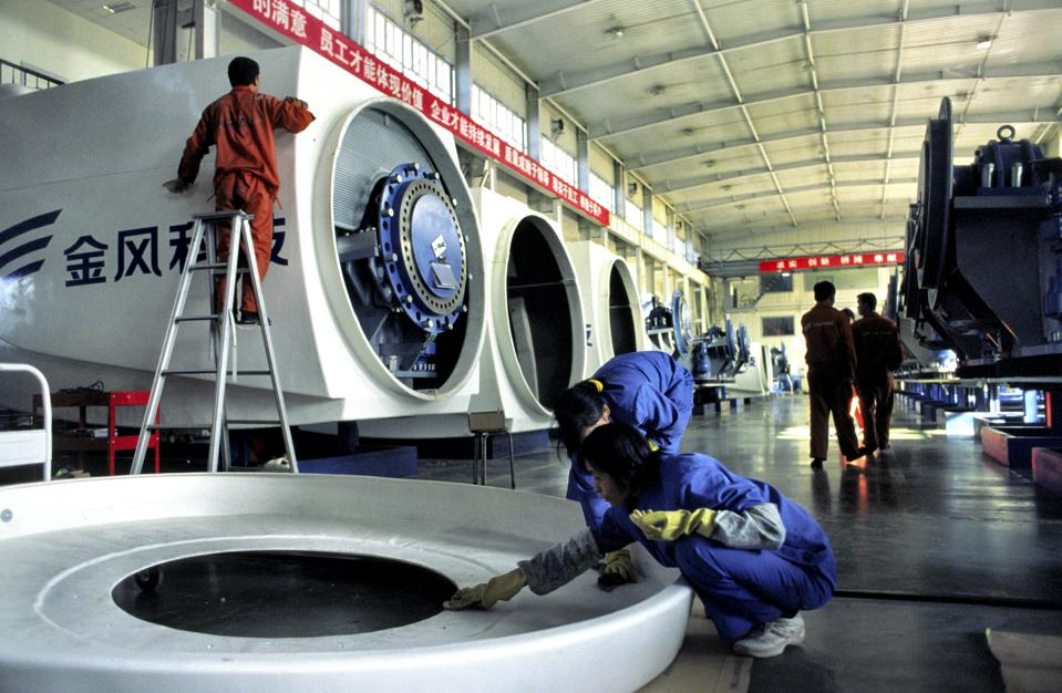 China - Xinjiang - Urumqi - Wind Turbine Manufacturing - Women Clean a Turbine Cover