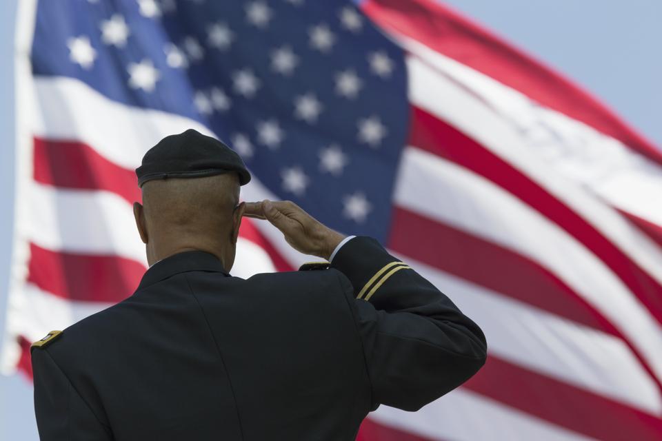 Retired Milton S Herring saluting US flag, Los Angeles National Cemetery Annual Memorial Event, California