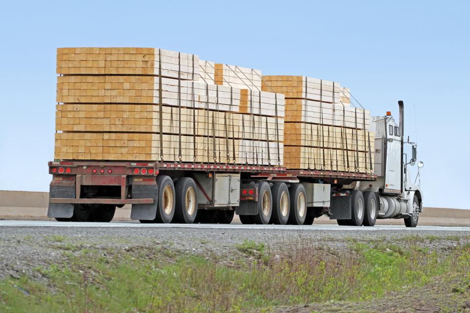 Semi Flatbed Truck Hauling A Load Of Lumber