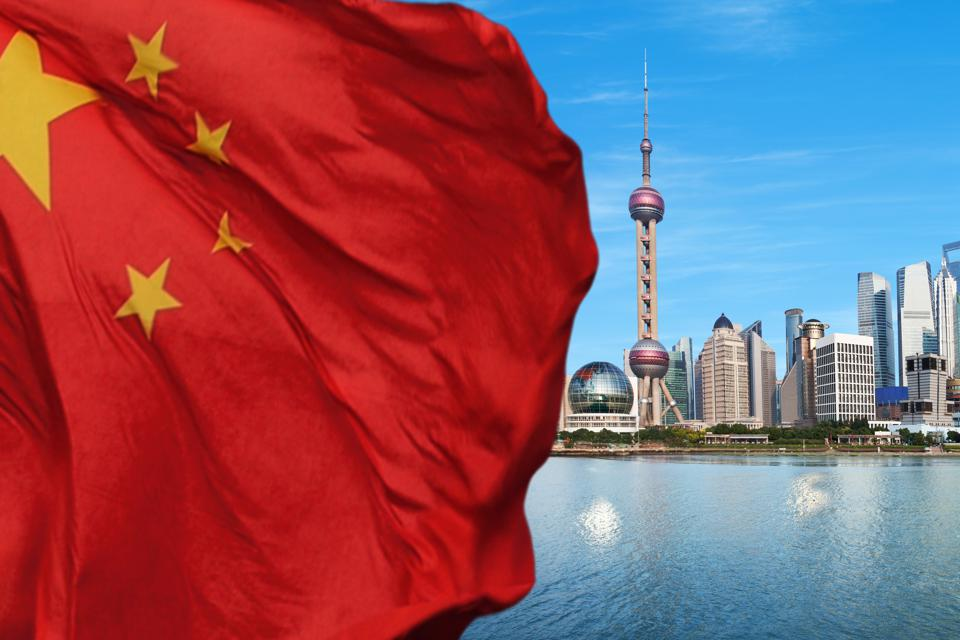 Shanghai Pudong with Chinese flag