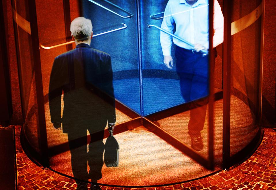 A businessman walking out of a revolving door, 24 November 2003. AFR Photo Ill