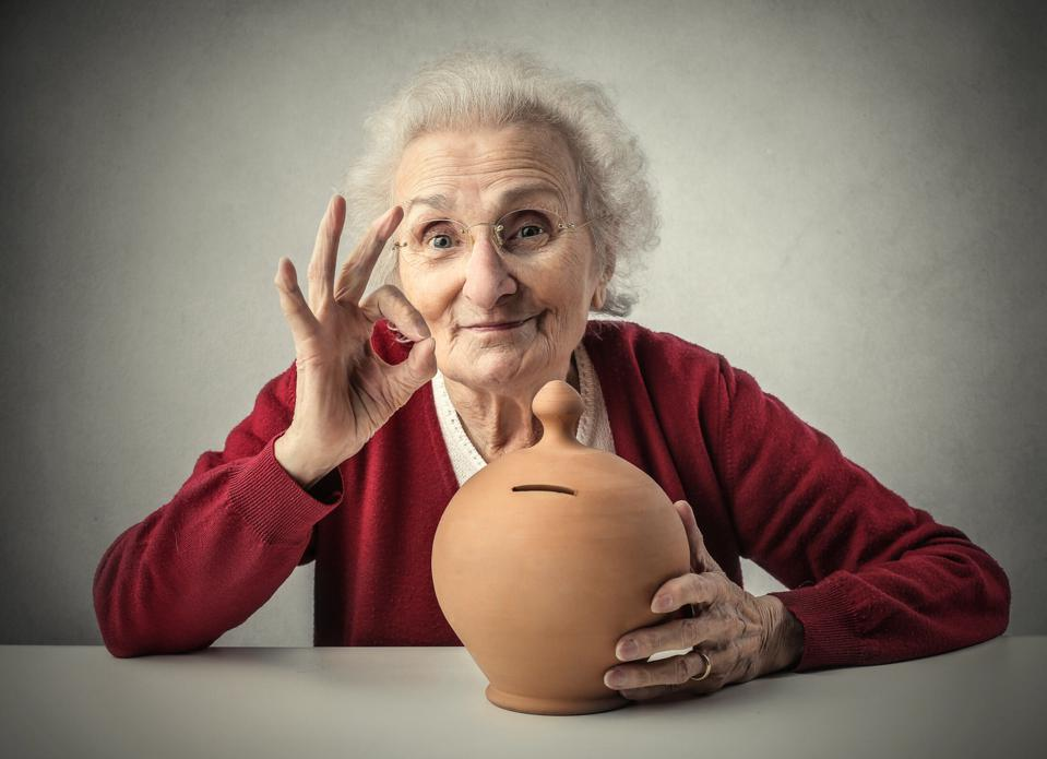 Happy Old lady with her saving