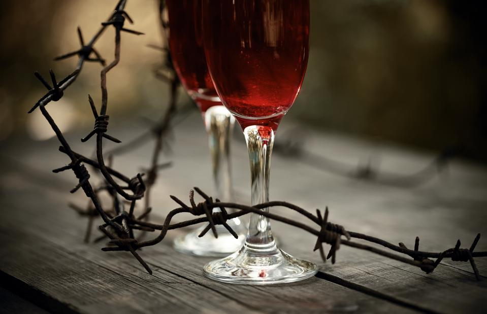 Wine in glasses and a barbed wire.