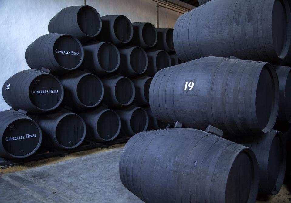 Oak barrels of maturing sherry wine cellar, Spain