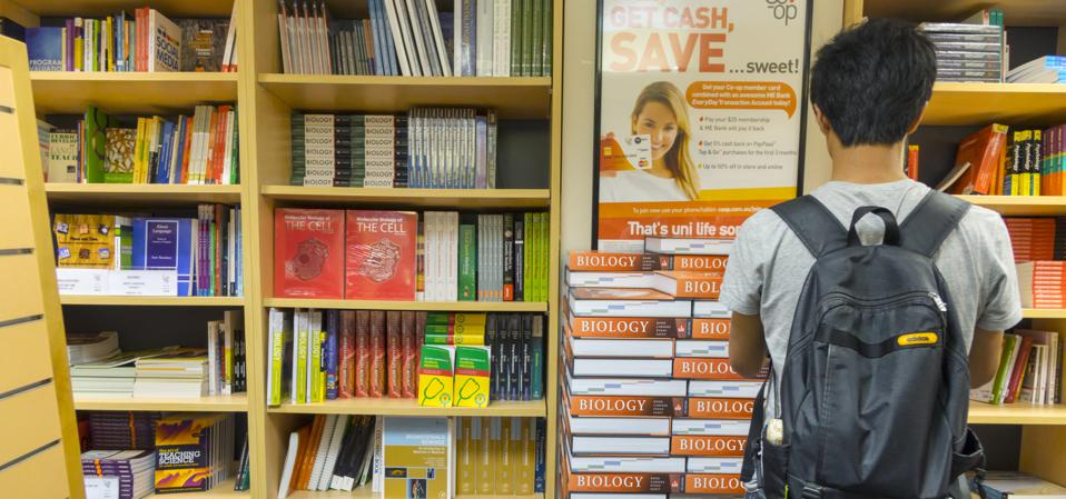 Student considers Biology books in a campus store.