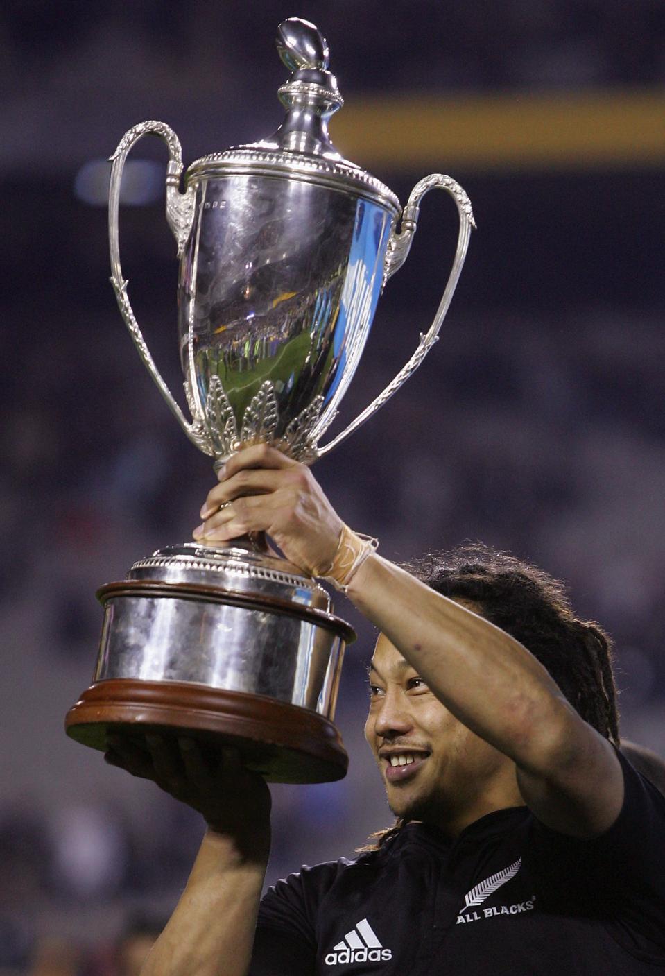 All Blacks captain Tana Umaga holds aloft the Tri-Nations Cup.