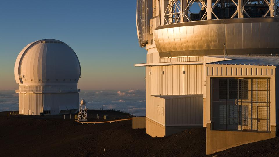 Data came from the Canada–France–Hawaii Telescope (CFHT) (on the left of this image) which is located near the summit of Mauna Kea mountain on Hawaii's Big Island at an altitude of 4,204 meters (Photo by Rolf Schulten/ullstein bild via Getty Images)